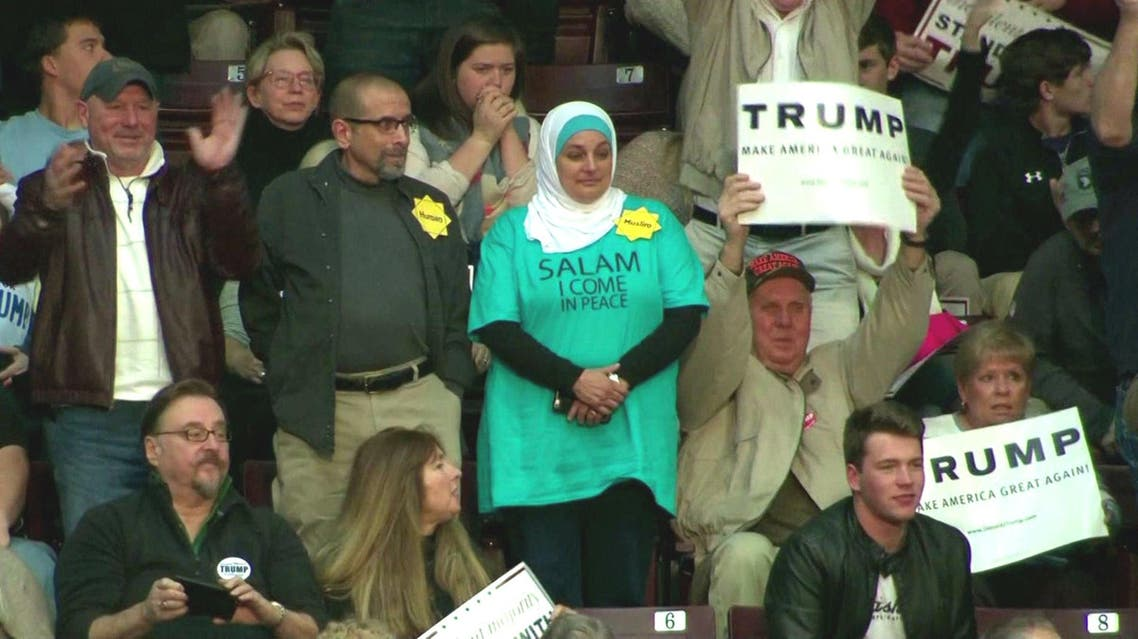 Rose Hamid, a 56-year-old flight attendant from North Carolina, stood up silently in the stands directly behind Trump. (Photo courtesy: CNN screenshot)
