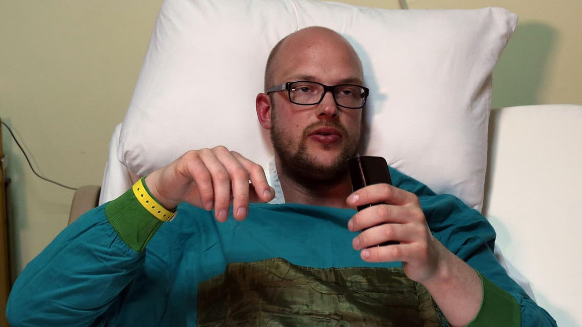Sam Eric, a 27-year-old tourist from Sweden recovers in bed at the Nile hospital in Egypt's Red Sea resort of Hurghada on January 9, 2016 after he was injured in an attack the previous day at the Bella Vista Hotel by knife-wielding assailants, in the latest blow to the country's beleaguered tourism industry. AFP