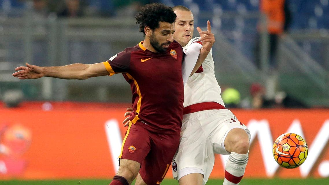 Roma's Mohamed Salah, left, and AC Milan's Luca Antonelli vie for the ball during an Italian Serie A soccer match between Roma and AC Milan at Rome's Olympic stadium, Saturday, Jan. 9, 2016. (AP