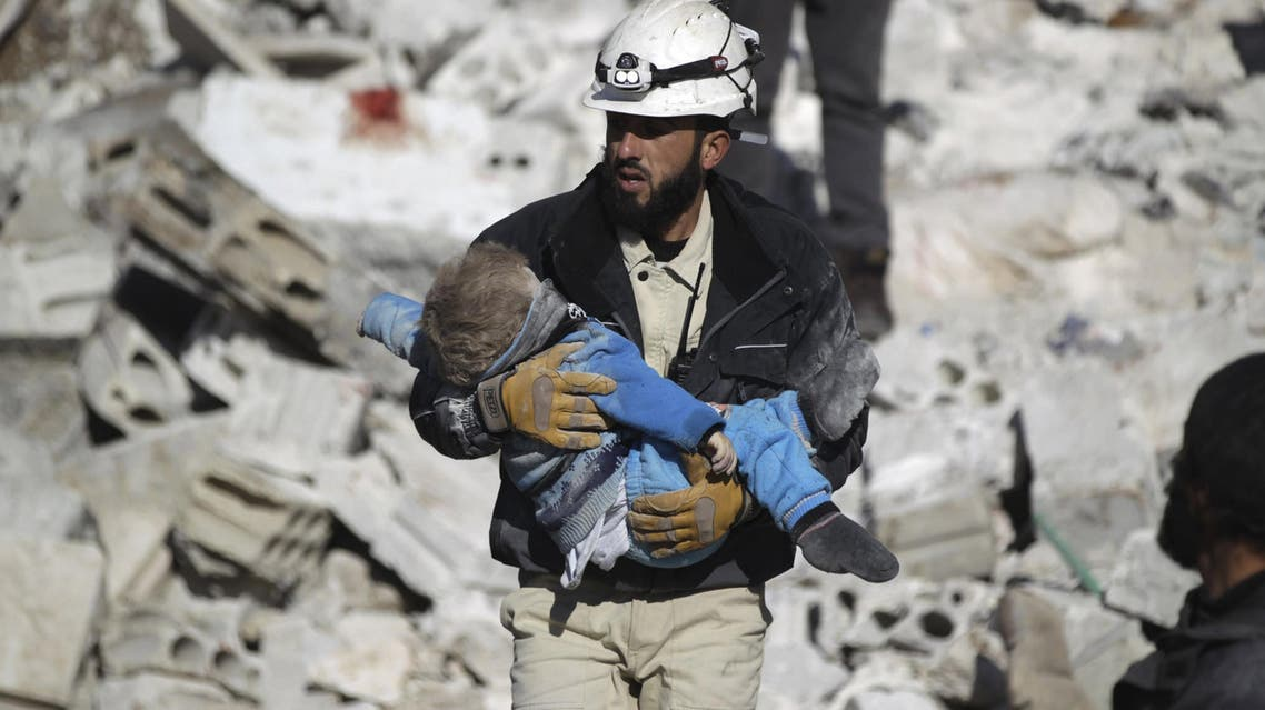 A civil defence member carries a dead child in a site hit by what activists said were airstrikes carried out by the Russian air force in the rebel-controlled area of Maaret al-Numan town in Idlib province, Syria January 9, 2016. Reuters