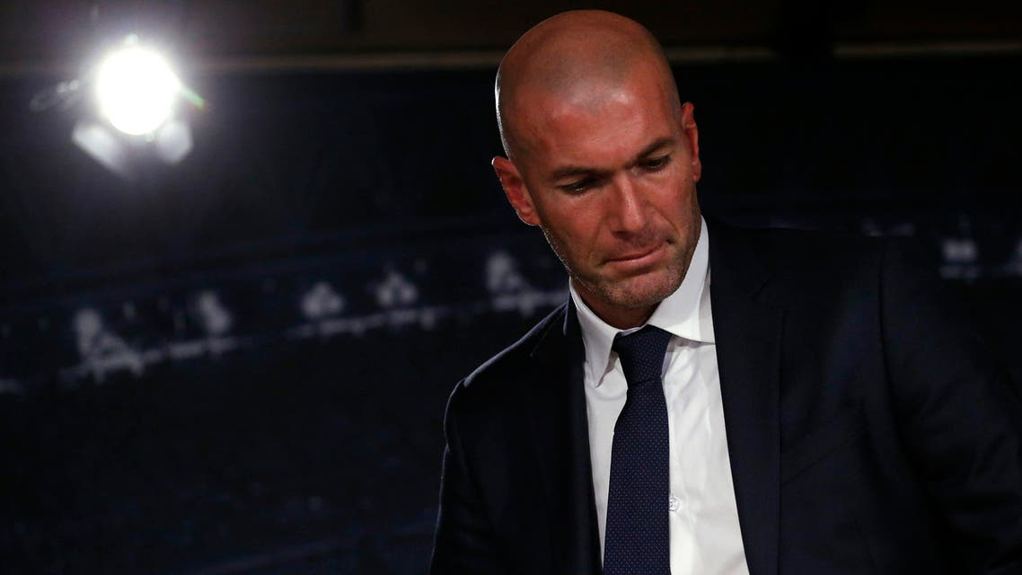 Real Madrid's new coach Zinedine Zidane leaves after a news conference at Santiago Bernabeu stadium in Madrid. (Reuters)