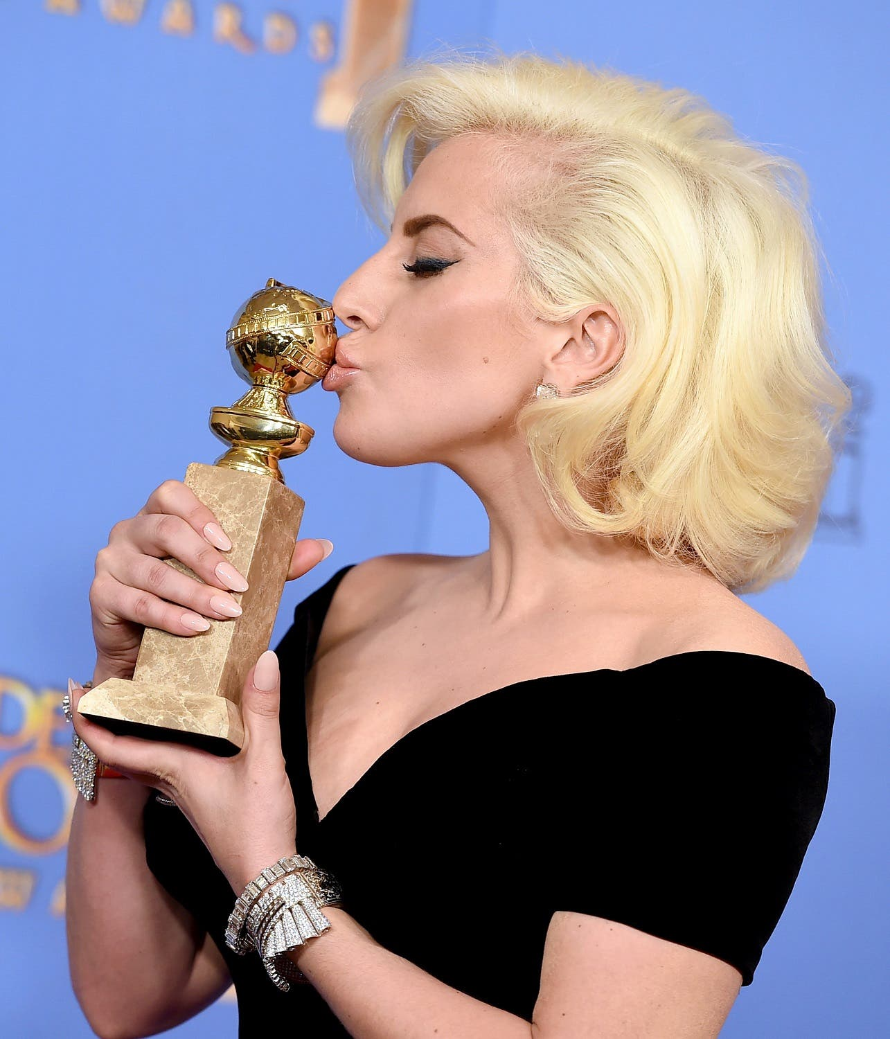 "Lady Gaga poses in the press room with the award for best performance by an actress in a limited series or a motion picture made for TV for ""American Horror Story: Hotel"" at the 73rd annual Golden Globe Awards. (AP)"