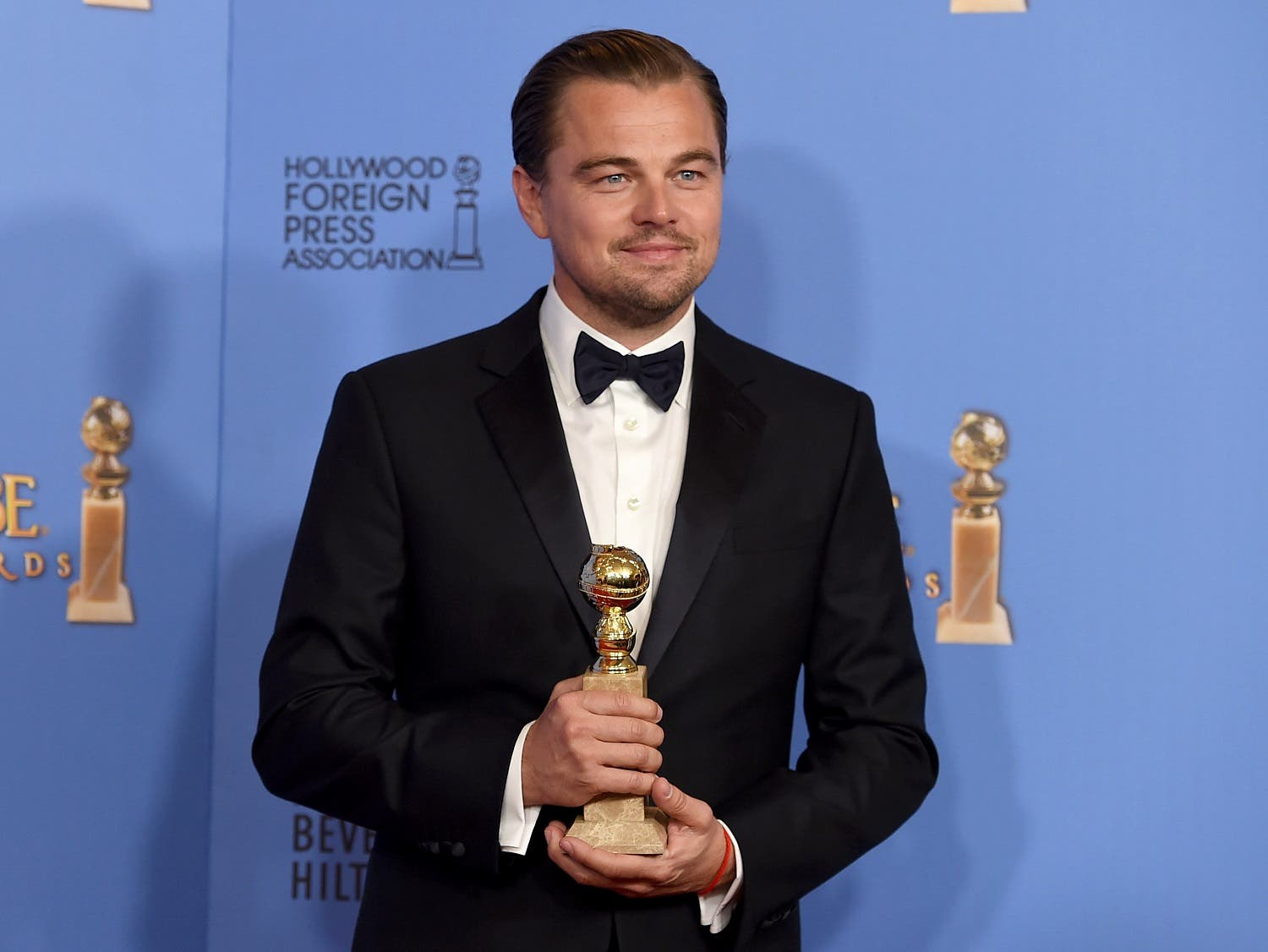 "Leonardo DiCaprio poses in the press room with the award for best actor in a motion picture - drama for ""The Revenant"" at the 73rd annual Golden Globe Awards. (AP)"