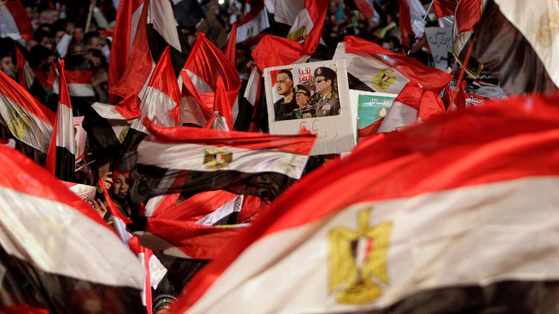 Supporters of Egypt's army chief General Abdel Fattah al-Sisi hold a poster of Sisi in Tahrir square in Cairo, on the third anniversary of Egypt's uprising, January 25, 2014. (Reuters)
