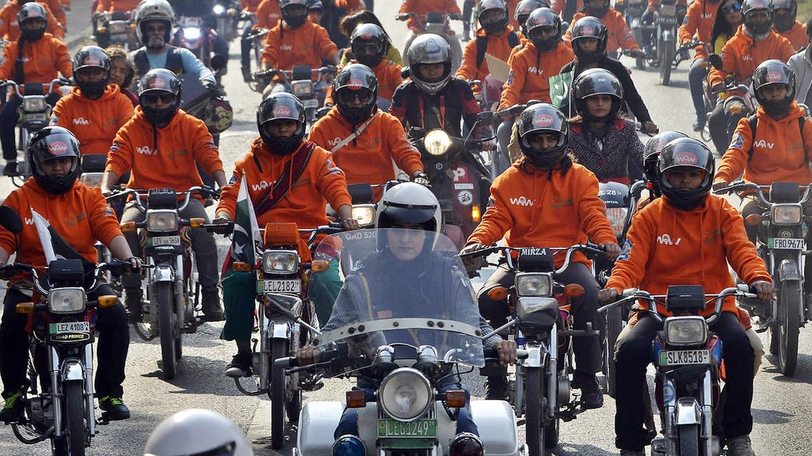 Women participants of Women on Wheels (WOW) ride their motor-bikes during a rally launching the Women on Wheels campaign in Lahore on January 10, 2016. AFP