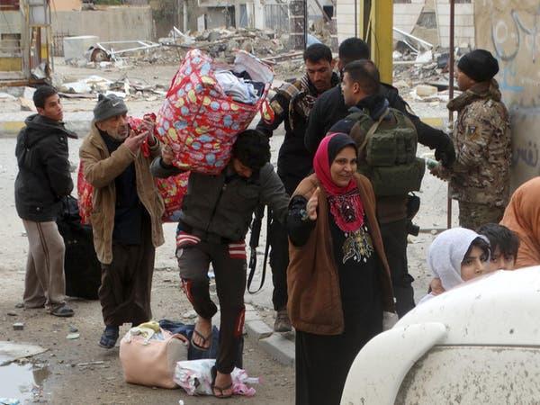 عوائل عراقية تعود لمنازلها بعد براءتها من صلتها بداعش