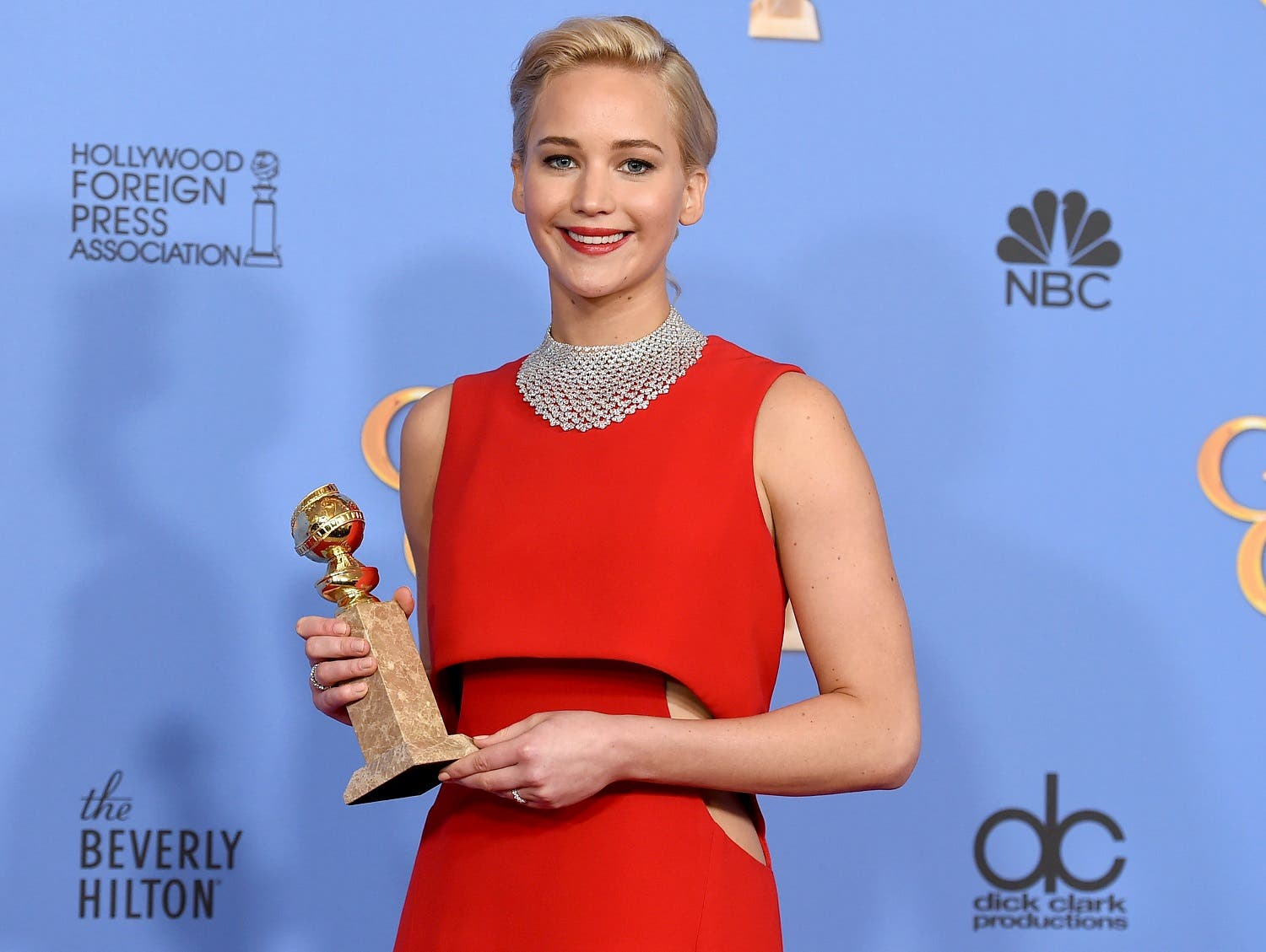 """Jennifer Lawrence poses in the press room with the award for best performance by an actress in a motion picture - musical or comedy for """"Joy"""" at the 73rd annual Golden Globe Awards. (AP)"""
