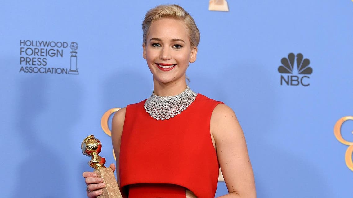 "Jennifer Lawrence poses in the press room with the award for best performance by an actress in a motion picture - musical or comedy for ""Joy"" at the 73rd annual Golden Globe Awards. (AP)"