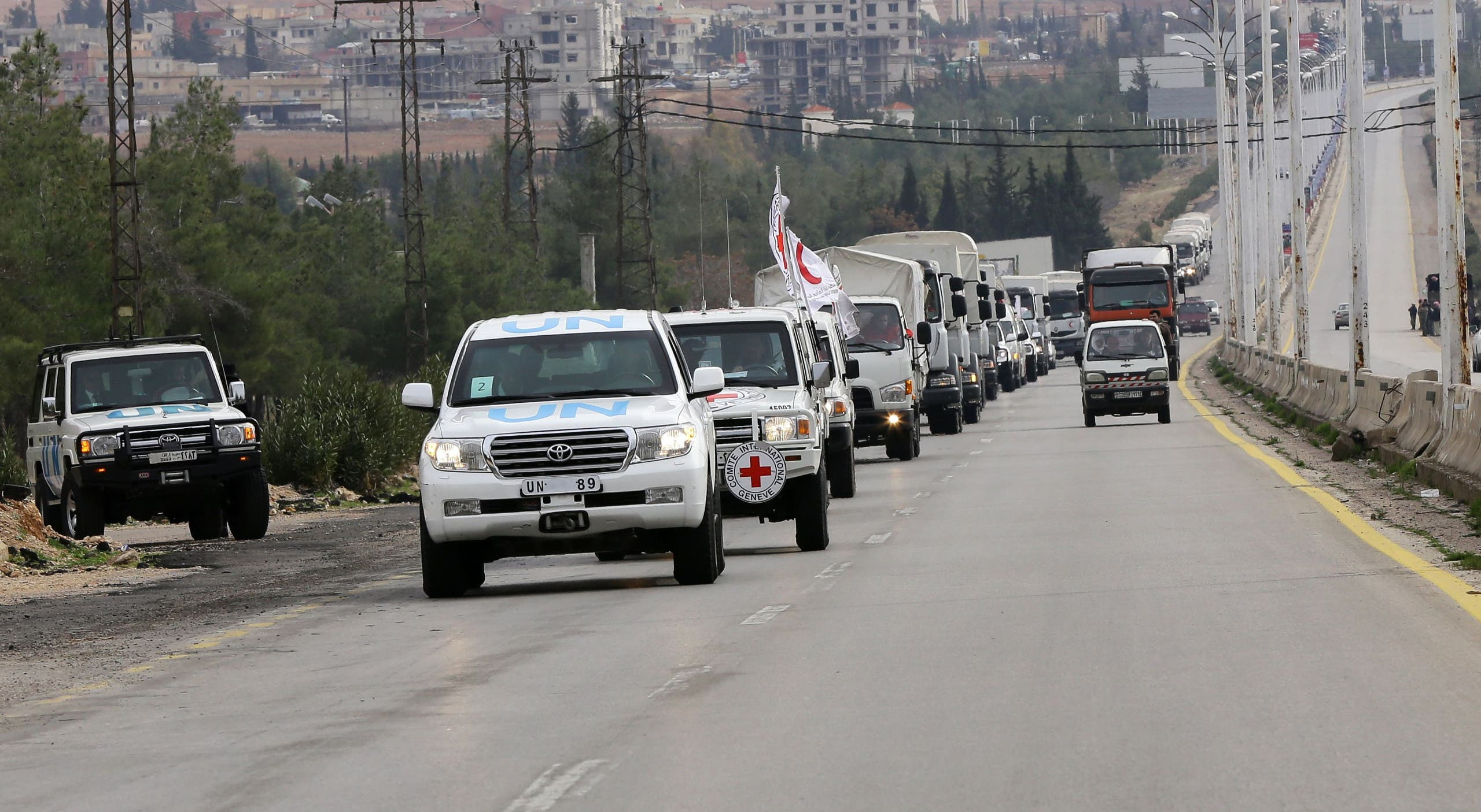 Aid convoys carrying food, medicine and blankets, leave the Syrian capital Damascus as they head to the besieged town of Madaya on January 11, 2015. AFP