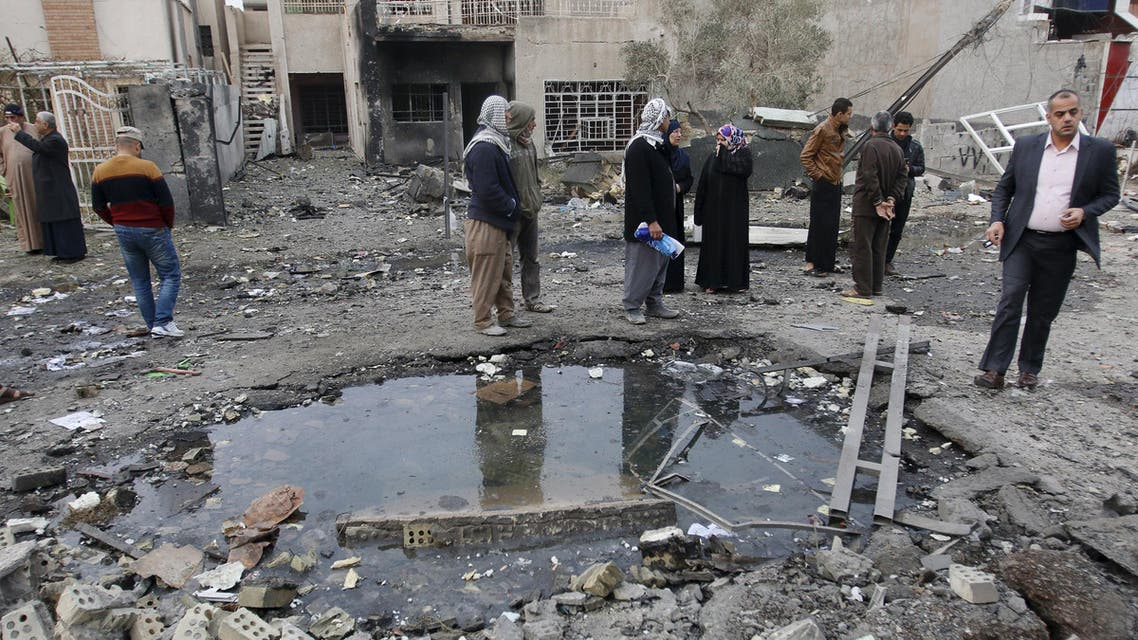 Residents gather at the site of a car bomb blast in New Baghdad, January 12, 2016. REUTERS/Khalid al Mousily