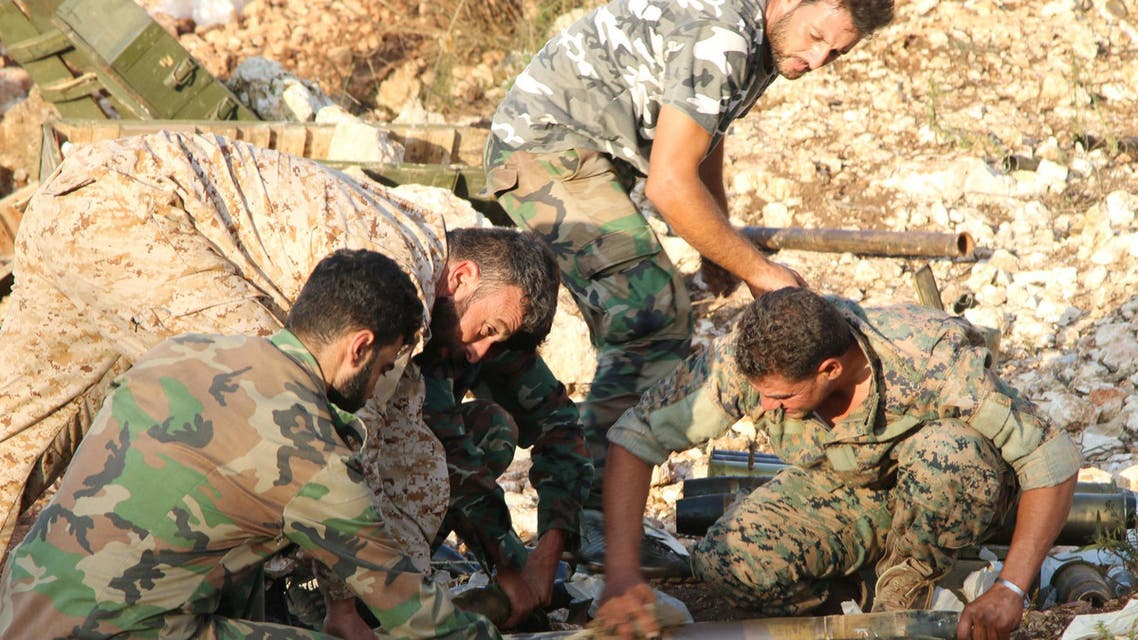 In this photo taken on Saturday, Oct. 10, 2015, Syrian army personnel prepare artillery ammunition in Latakia province, about 12 miles from the border with Turkey, Syria.  (AP)
