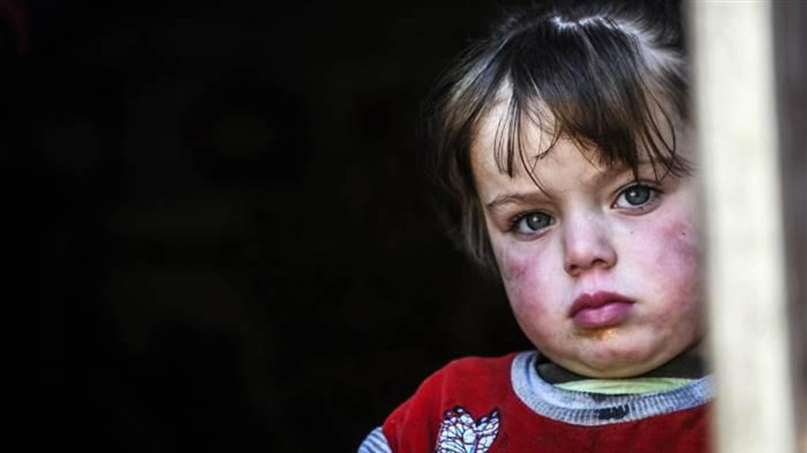 A Syrian refugee child looks out from a shelter in Hatay, Turkey. (File photo: AFP)