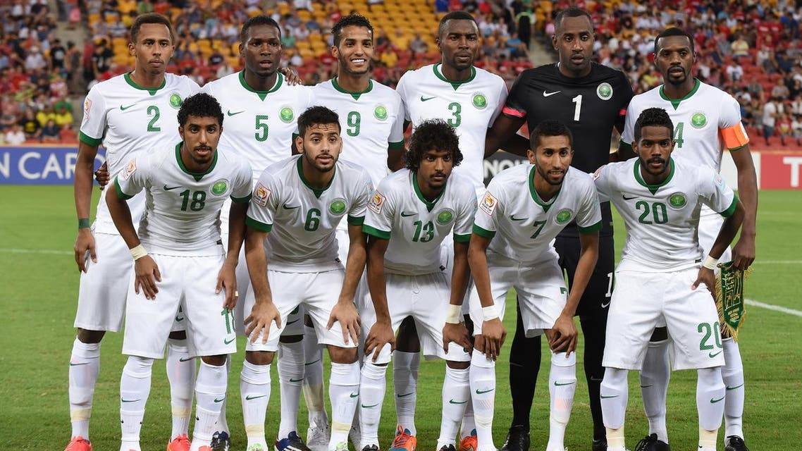 The Saudi Arabian team pose for steam photo ahead of their first round soccer match of the AFC Asia Cup against China in Brisbane, Australia, Saturday, January 10, 2015. (AP)