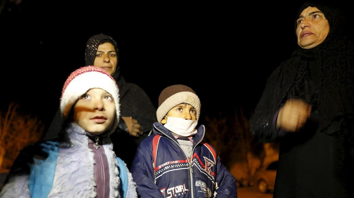 Residents who say they have received permission from the Syrian government to leave the besieged town depart after an aid convoy entered Madaya. (Reuters)