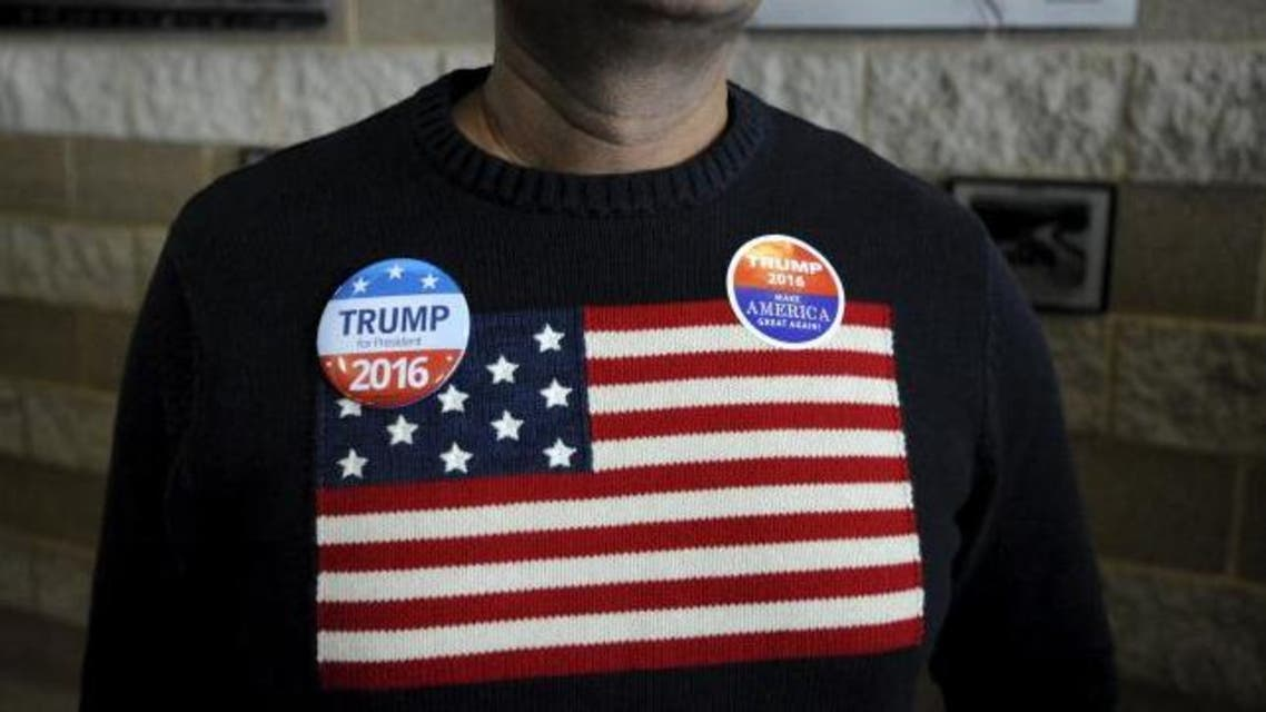 A supporter of U.S. Republican presidential candidate Donald Trump waits to enter the auditorium at the Bridge View Center ahead of a campaign event in Ottumwa, Iowa, January 9, 2016. (Reuters)