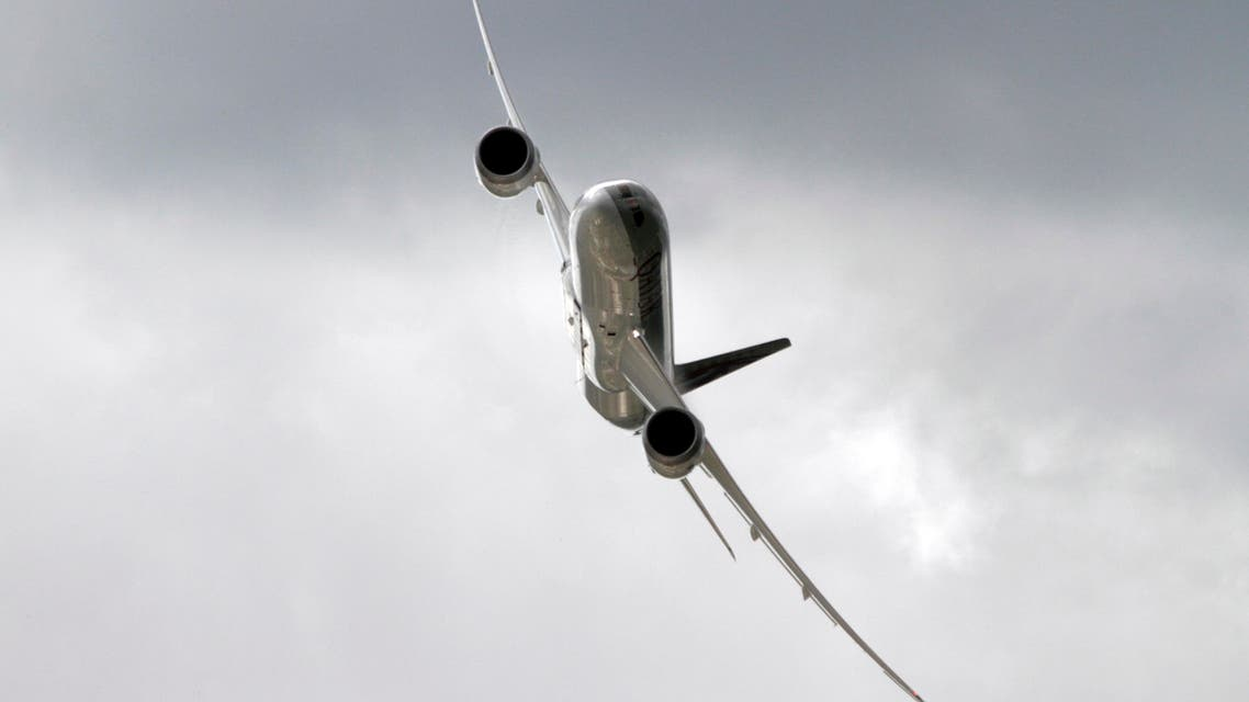 A Qatar Airways Boeing 787 Dreamliner flies during a flying display at the third day at the Farnborough International Airshow, in Farnborough, England, Wednesday, July 11, 2012.  (AP)