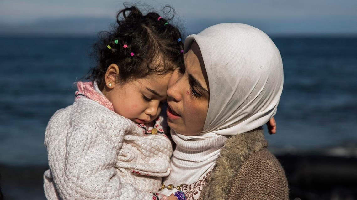 A Syrian mother hugs her child after they arrived from Turkey at the Greek island of Lesbos on an overcrowded inflatable boat. (AP)