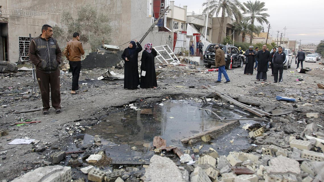 Residents gather at the site of a car bomb blast in New Baghdad, January 12, 2016.  (Reuters)