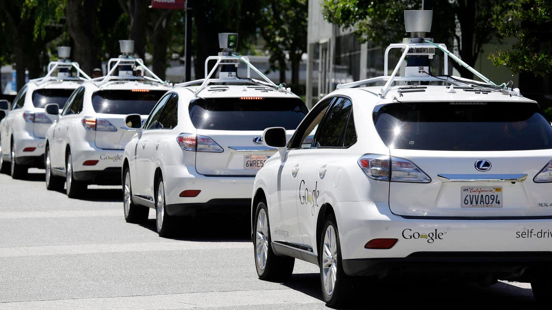 This May 13, 2014 file photo shows a row of Google self-driving Lexus cars at a Google event outside the Computer History Museum in Mountain View, Calif.  (AP)