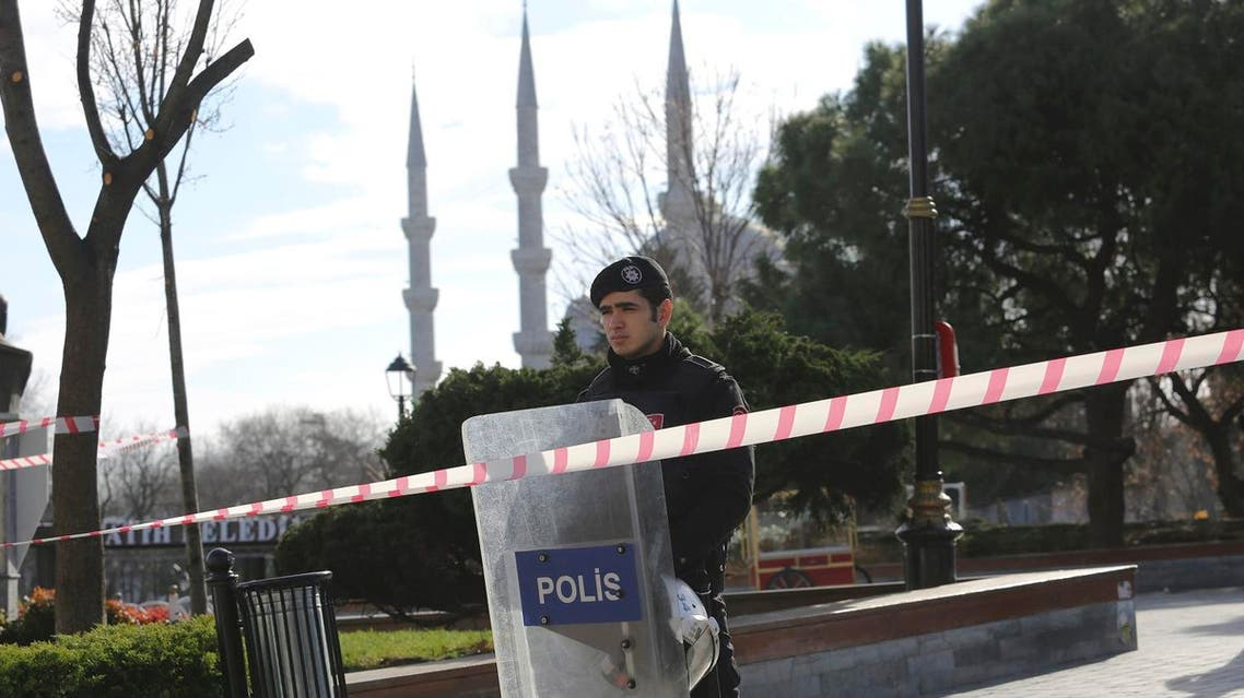 Police office secures area after an explosion near the Ottoman-era Sultanahmet mosque in Istanbul. (AP)