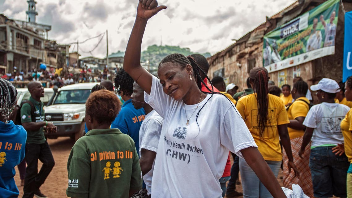 A woman celebrates with others as the country is declared Ebola free in the city of Freetown, Sierra Leone, Saturday, Nov. 7, 2015.  (AP)