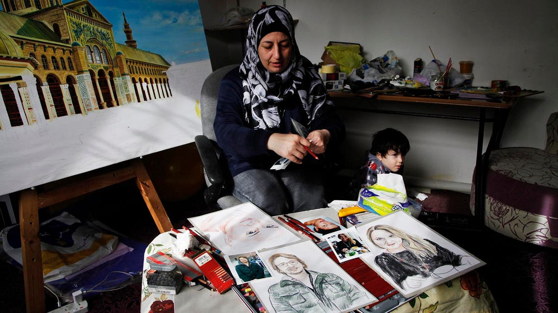 "In this Thursday, Jan. 7, 2016 photo, Lina Mahameed, a Syrian artist and refugee from Daraa, works on portraits of some of the people killed in the Nov. 13 attacks in Paris by the Islamic State extremist group, in Amman, Jordan. One of Mahameed's three surviving children, six-year-old Rayan, stands nearby as she reviews photographs of victims she downloaded from the Internet. Mahameed, whose 16-year-old son Yasser was killed at the beginning of Syria's civil war, hopes to send her portraits to the victims' families to show that ""their tragedy is like our tragedy."" (AP Photo/Sam McNeil)"