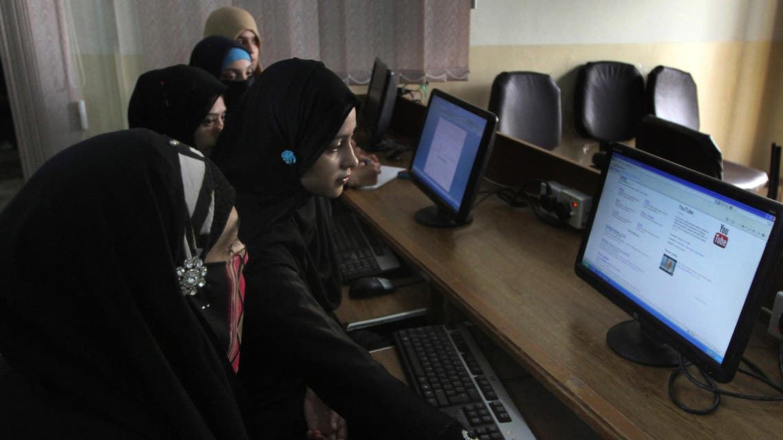 In this picture taken on Wednesday, Sept. 5, 2013, Pakistani university students try to access YouTube in Karachi, Pakistan. For almost a year, Pakistanis wanting to watch the video-sharing website YouTube have had to find other alternatives. The site has been banned since Sept. 17, 2012 after Pakistani officials acting in response outrage across the country over the airing of an anti-Islamic film blocked access to YouTube. (AP Photo/Shakil Adil)