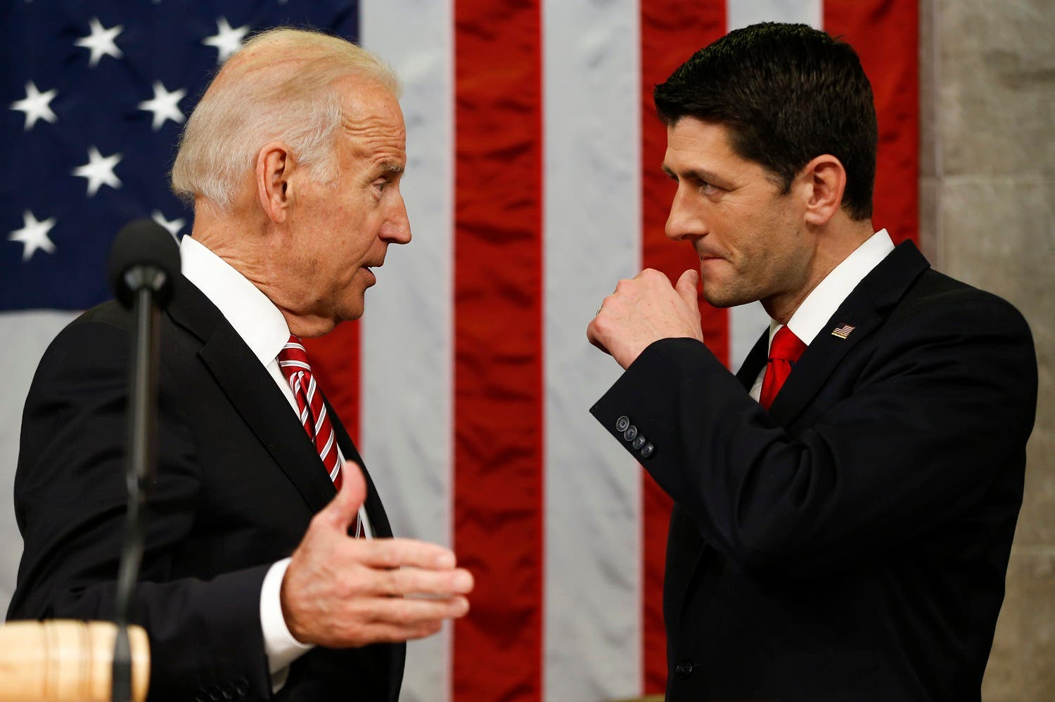 President Barack Obama shakes hands with House Speaker Paul Ryan of Wisconsin as Vice President Joe Biden watches before the State of the Union address to a joint session of Congress on Capitol Hill in Washington. (AP)
