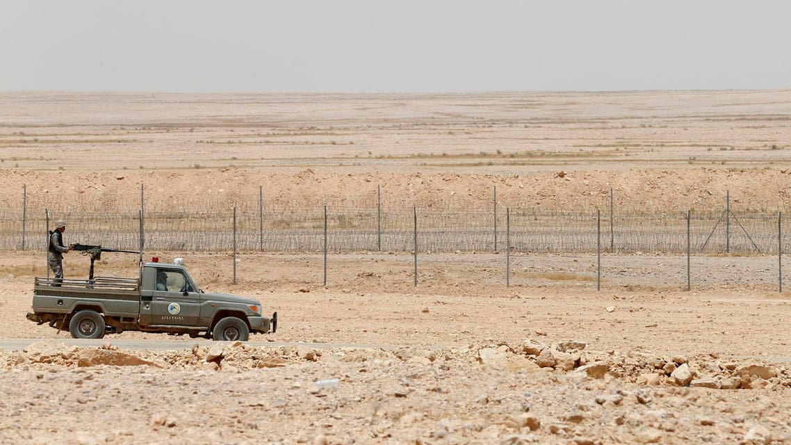 A military truck belonging to the Saudi border guards force patrol near a fence on Saudi Arabia's northern borderline with Iraq July 14, 2014. (Reuters)