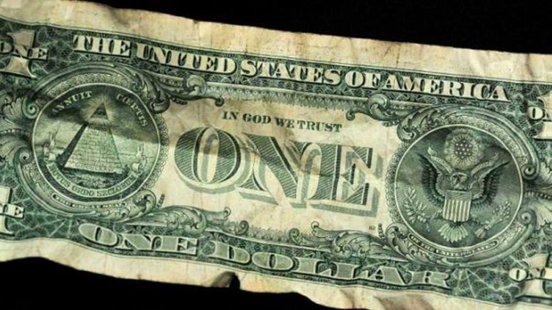 العبارة على الدولار، تثير غيظ الملحدين دائم