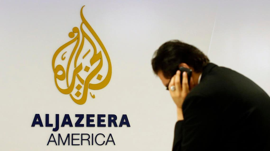 File photo of a man working at a desk in the Al Jazeera America broadcast center in New York. (Reuters)