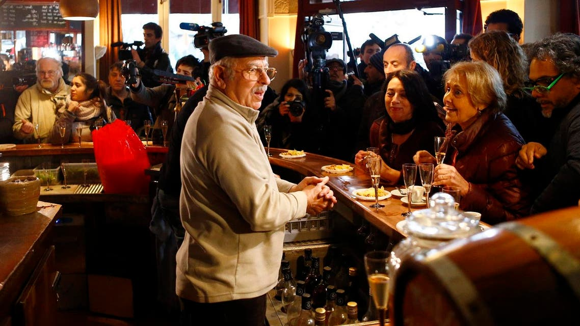 Owner of the Carillon restaurant, Mokrane Hadjem, nicknamed 'Coco' welcomes customers during the re-opening exactly two months after the November attacks, in Paris. (AP)