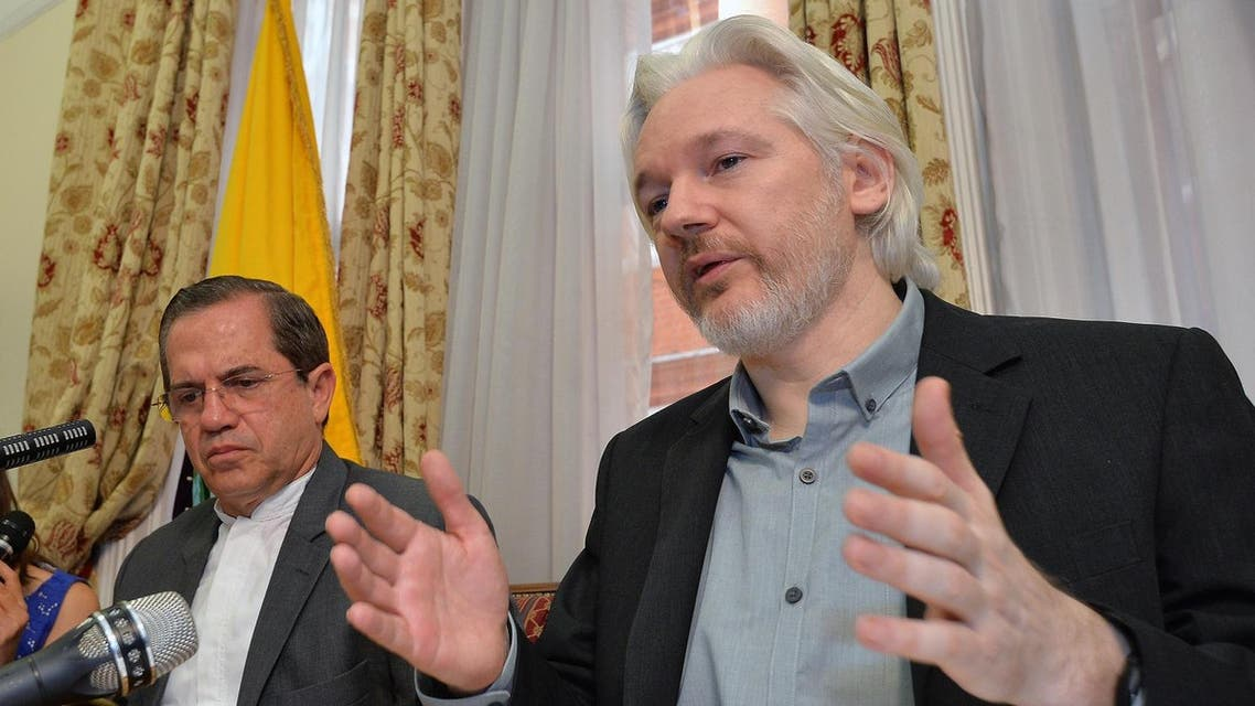 Ecuador's Foreign Minister Ricardo Patino, left, and WikiLeaks founder Julian Assange speak during a news conference inside the Ecuadorian Embassy in London. (AP)