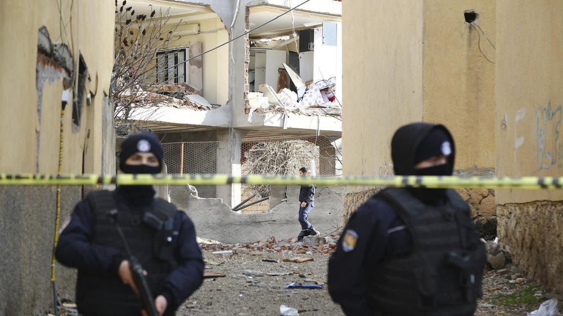 Turkish police stand guard near a building damaged by a truck bomb attack on a police station, in Cinar in the southeastern city of Diyarbakir, Turkey, January 14, 2016. Kurdish militants have attacked the police station in southeast Turkey with a truck bomb, killing six people including a baby and two toddlers, in one of the biggest strikes since the conflict reignited in July, security officials said on Thursday. REUTERS/Sertac Kayar