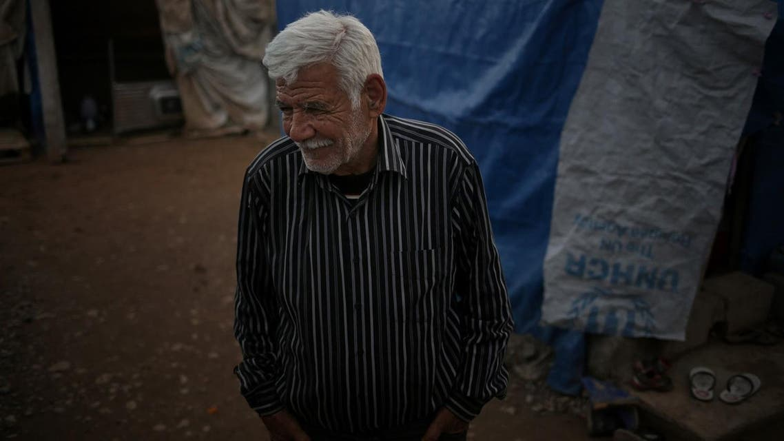 Ibrahim Mahmoud stands in Baharka refugee camp in Iraq's northern Kurdish region. (AP)