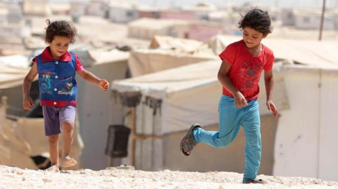 Young Syrian refugees play at the UN-run Zaatari camp, north east of the Jordanian capital Amman. (AFP)