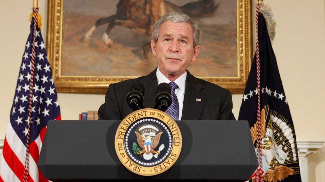President George W. Bush pauses during a statement on the auto industry at the White House on Friday, December 19, 2008 in Washington. (AP
