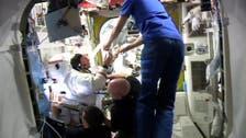 Spacewalk aborted after water leaks into astronaut's helmet