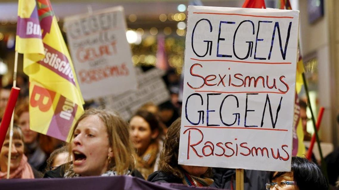 """Asylum seekers in Germany are said to be suspects in the mass sexual assault in Cologne on the eve of New Year. Picture: Women shout slogans of """"Against Sexism - Against Racism"""" as they march through the main railways station of Cologne, Germany, January 5, 2016 (Reuters)"""