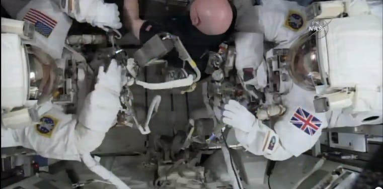 This photo taken from video provided by NASA shows astronaut Scott Kelly, center, help gather equipment for U.S. astronaut Tim Kopra, left, and British astronaut Tim Peake, as they prepare for a space walk at the International Space Station on Friday, Jan. 15, 2016. Peake will become the first Briton to walk in space when he ventures out of the International Space Station (ISS) to help repair a broken power unit. (NASA via AP)