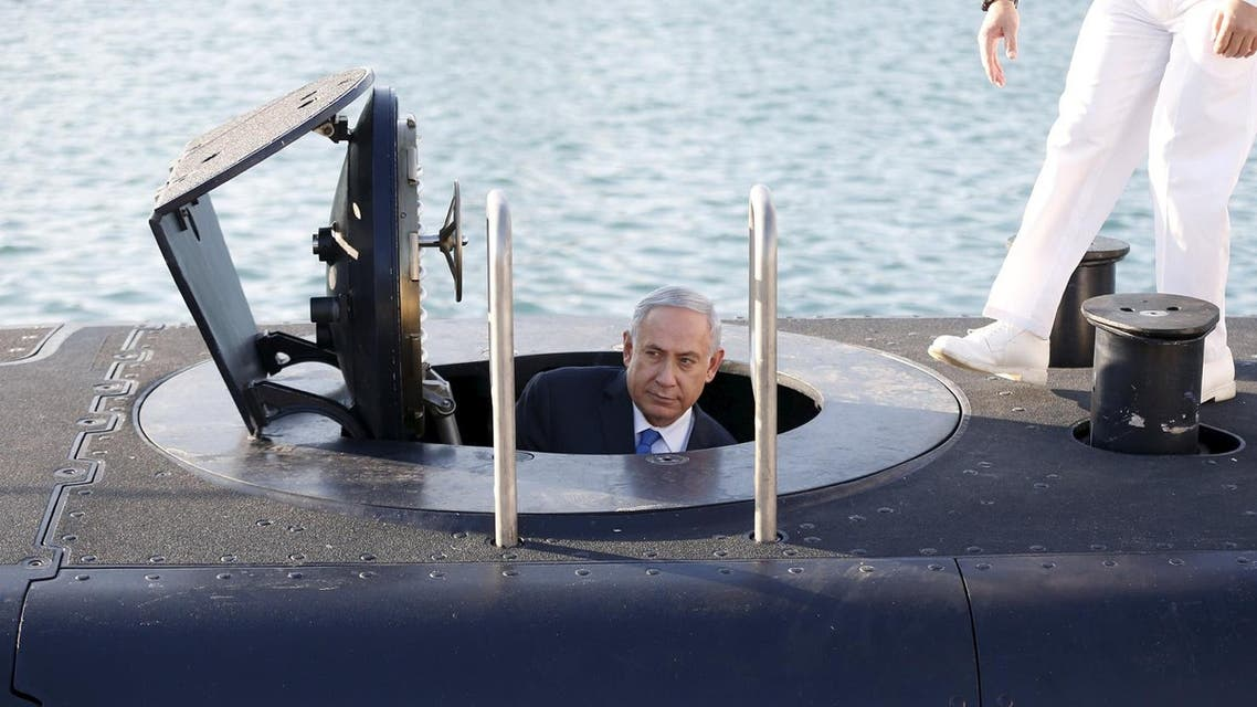 Israeli Prime Minister Benjamin Netanyahu climbs out after a visit inside the Rahav, the fifth submarine in the fleet, after it arrived in Haifa port. (Reuters)