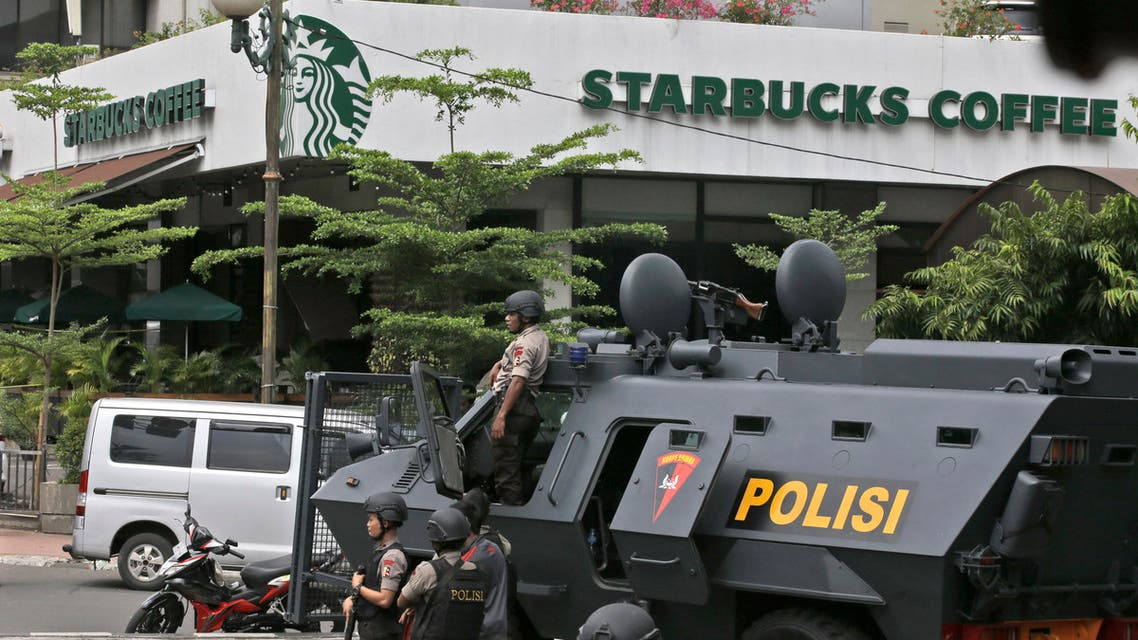 A police armored vehicle is parked outside a Starbucks cafe after an explosion in Jakarta, Indonesia Thursday, Jan. 14, 2016.  AP