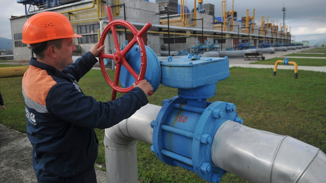 In this Wednesday, Oct. 7, 2015 file photo, a worker at a Ukrainian gas station Volovets in western Ukraine controls a valve. AP