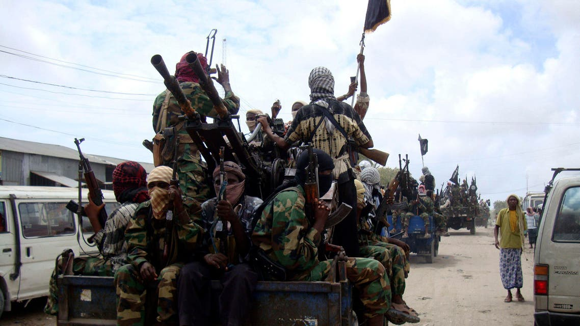 In this photo of Thursaday, Oct.21, 2010, Al-Shabaab fighters display weopons as they conduct military exercises in northern Mogadishu, Somalia AP