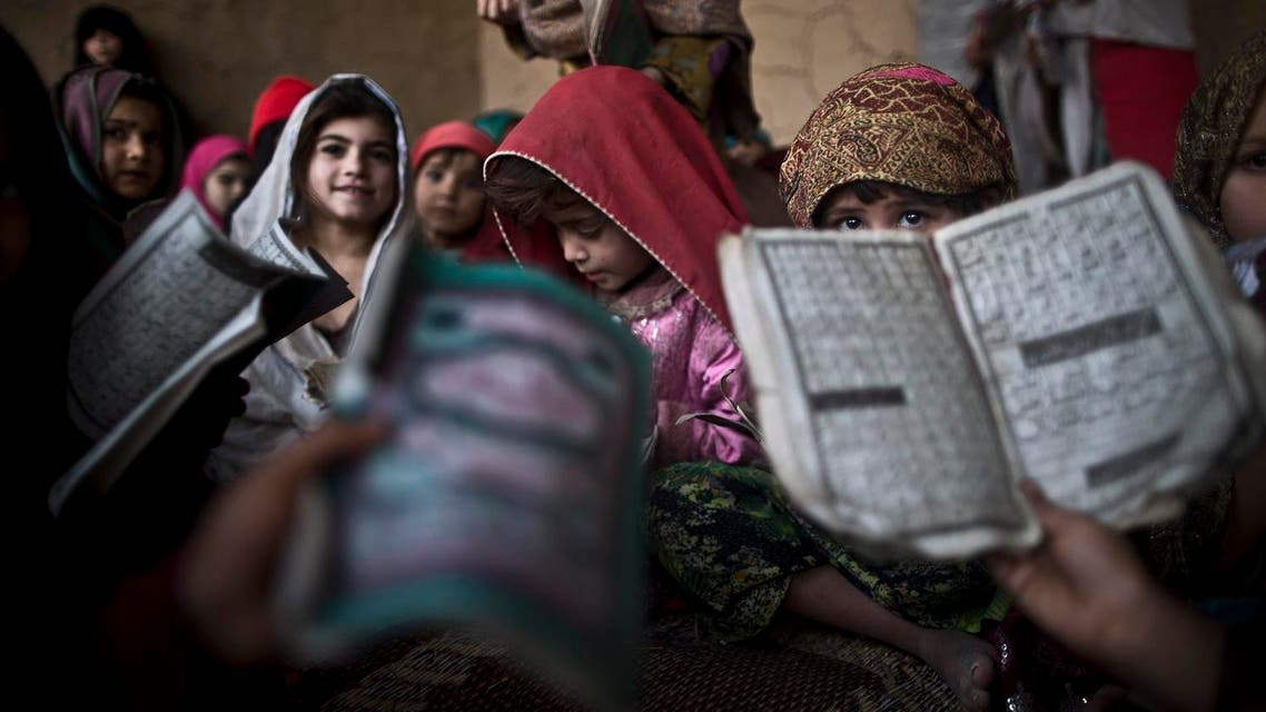 Pakistani children hold booklets of Urdu alphabets and verses of the Quran during their daily Madrassa, or Islamic school, at a mosque on the outskirts of Islamabad, Pakistan, Tuesday, Jan. 28, 2014. (AP)
