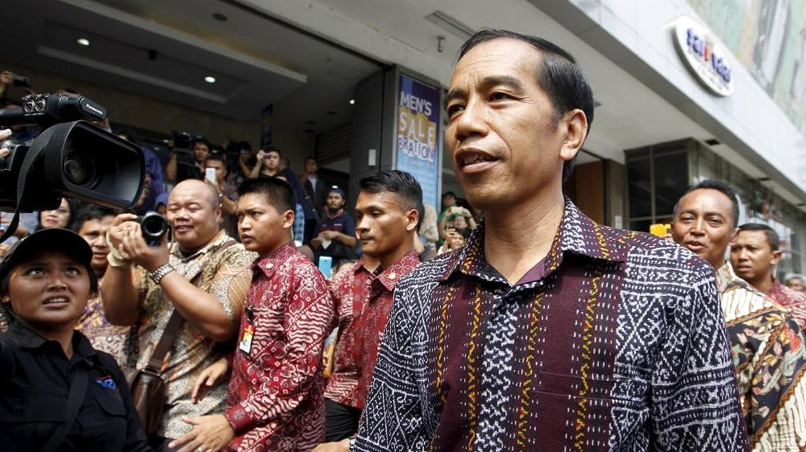 Indonesia's President Joko Widodo visits a department store located near Thursday's gun and bomb attack in central Jakarta January 15, 2016 (Reuters)