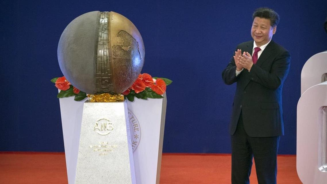 Chinese President Xi Jinping applauds after unveiling a sculpture during the opening ceremony of the Asian Infrastructure Investment Bank (AIIB) in Beijing, China, January 16, 2016 (Reuters)