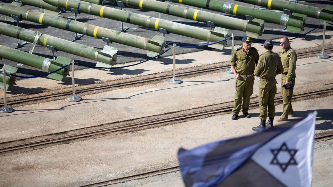 Israeli naval officer stand next to dozens of rockets on display after being seized from the Panama-flagged KLOS C civilian cargo ship that Israel intercepted last Wednesday off the coast of Sudan, at a military port in the Red Sea city of Eilat, southern Israel, Monday, March 10, 2014. AP