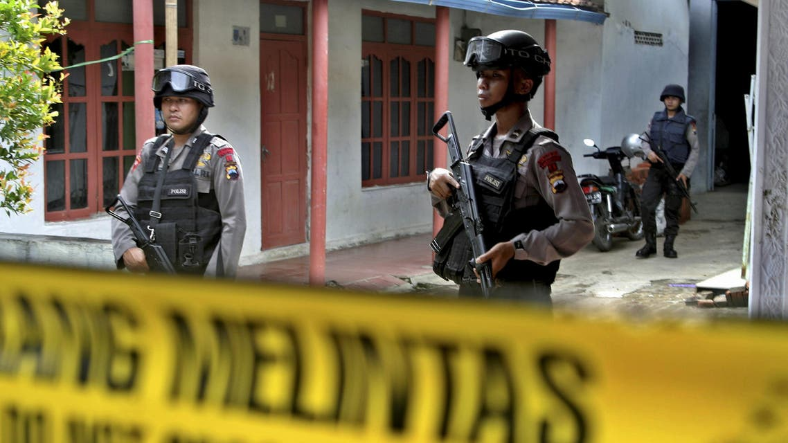 Armed police stand in front a house whose owner was arrested during a raid in the Langgen village in Tegal, Indonesia Central Java, January 15, 2016 in this photo taken by Antara Foto. reuters