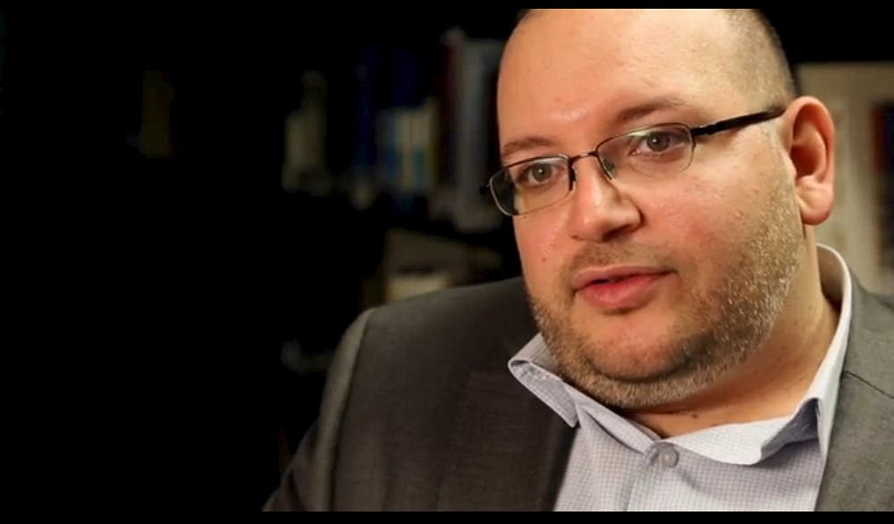 Jason Rezaian, the Washington Post's Tehran correspondent, is pictured at The Washington Post in Washington, DC in this November 6, 2013 handout photo. Rezaian was one of four American prisoners released by Iran ahead of the expected lifting of international sanctions on Iran January 16, 2016 as part of a deal between major powers and Iran to curb Tehran's nuclear program. REUTERS/Zoeann Murphy/The Washington Post/Handout via Reuters